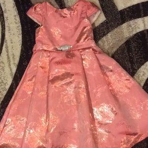 Beautiful coral dress with rhinestone bow